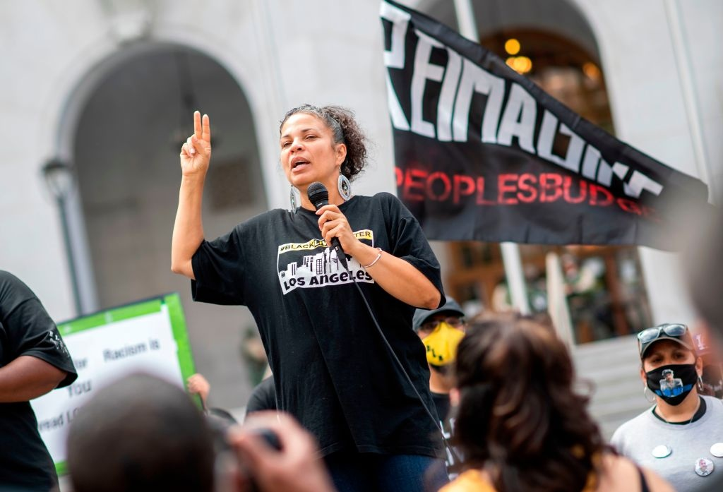 Melina Abdullah from Black Lives Matter addresses the crowd during a demonstration to ask for the removal of District Attorney Jackie Lacey in front of the Hall of Justice, in Los Angeles, California, on June 17, 2020. (Photo by VALERIE MACON / AFP) (Photo by VALERIE MACON/AFP via Getty Images)