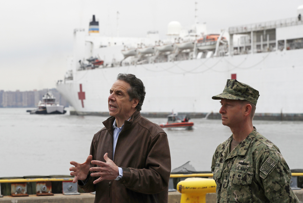 New York Gov. Andrew Cuomo, left, speaks after the arrival of the USNS Comfort, a naval hospital ship with a 1,000 bed-capacity.