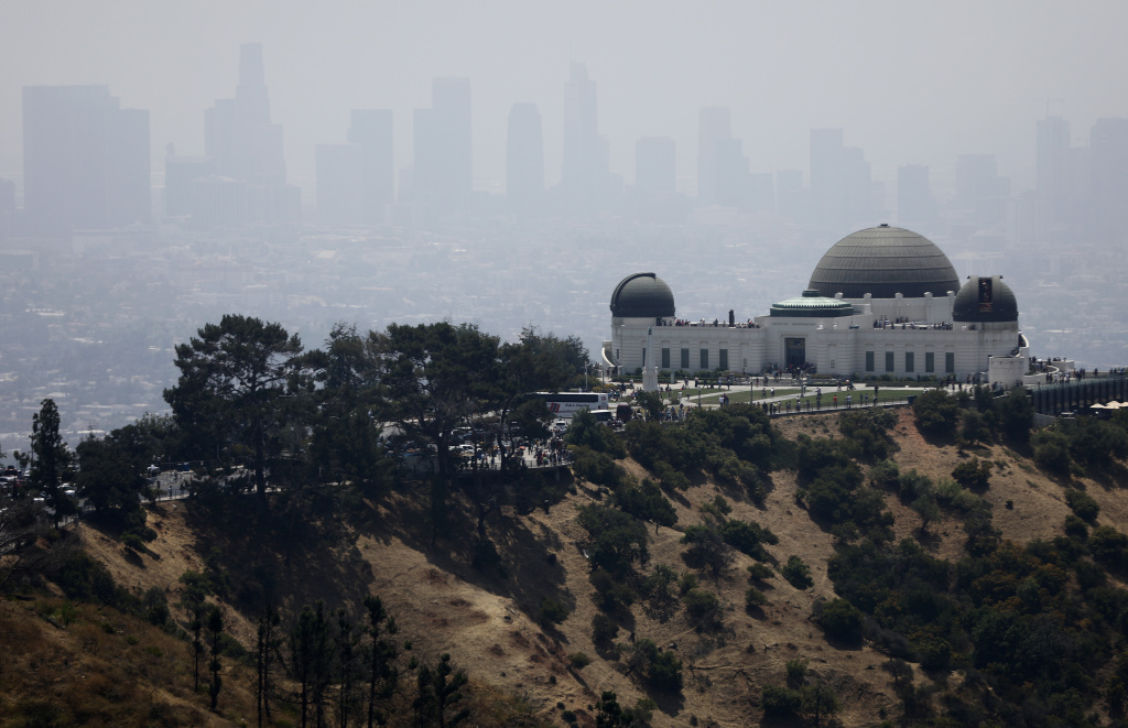 The Griffith Observatory stands (R) in front of downtown Los Angeles on July 5, 2019 in Los Angeles, California.