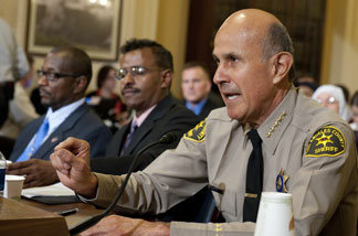 Leroy Baca (R), Sheriff of Los Angeles County, Melvin Bledsoe (L), and Abdirizak Bihi (C), director of the Somali Education and Social Advocacy Center testify before the Committee on Homeland Security holds the first in a series of hearings on radicalization in the American Muslim community, on Capitol Hill in Washington, DC, March 10, 2011.