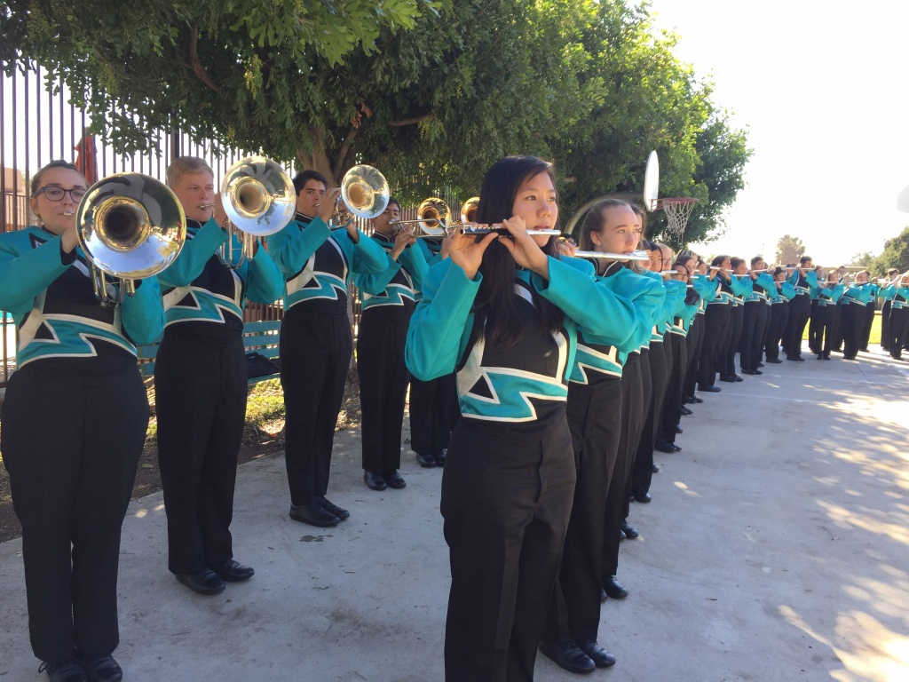 The Bands of Santiago Sharks from Santiago High School in Corona play songs about California and America at Five Acres, a children & family services agency in Altadena.