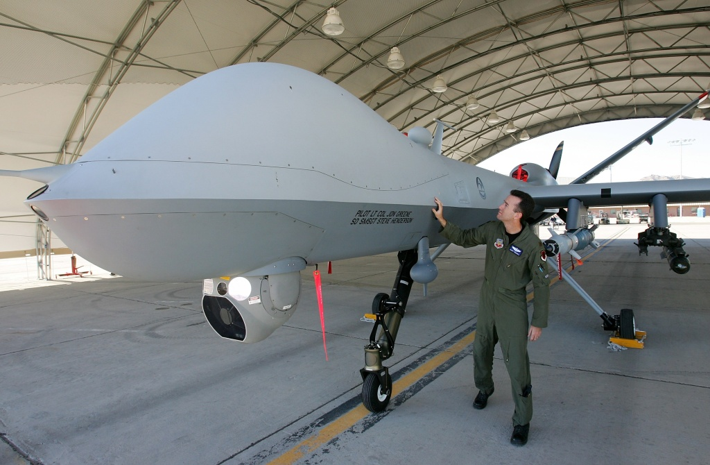 U.S. Air Force Maj. Casey Tidgewell inspects an MQ-9 Reaper as he performs a pre-flight check August 8, 2007 at Creech Air Force Base in Indian Springs, Nevada. The Reaper is the Air Force's first