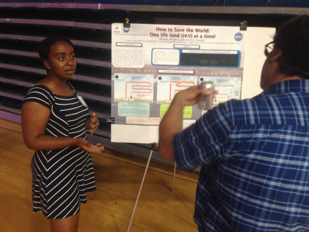 High school science teacher Natalie Wright (left) explains science research she carried out at the California Teachers' Summit at CSU Fullerton.