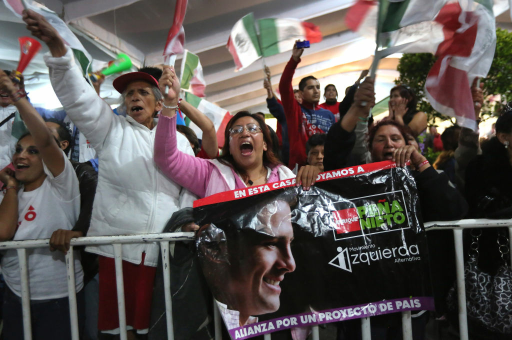 Supporters cheer PRI presidential candidate Enrique Pena Nieto at his victory speech on July 1, 2012 in Mexico City, Mexico. Pena Pena Nieto gave a victory speech to supporters after early results announced by the Federal Electoral Institute gave him a substantial lead over Andres Manuel Lopez Obradorto be Mexico's next president.
