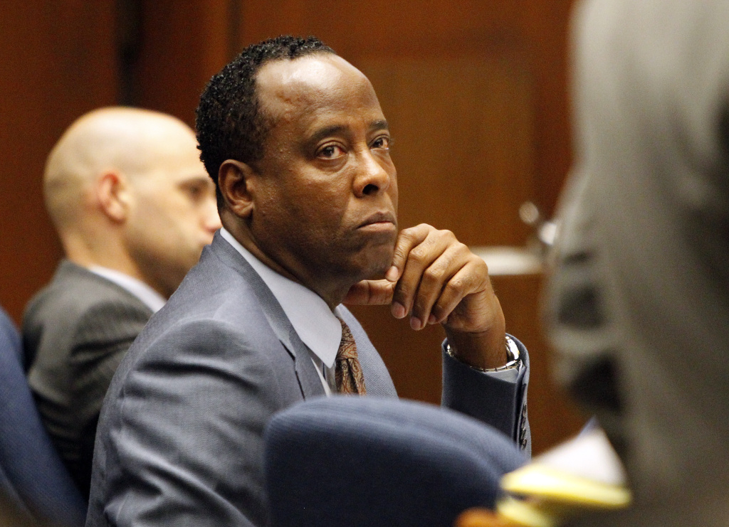 Defendant Dr. Conrad Murray looks to his defense attorney J. Michael Flanagan during his involuntary manslaughter trial at the Los Angeles Superior Court on September 29, 2011 in downtown Los Angeles, California. Murray is charged in the death of singer Michael Jackson who died of an overdose of prescription drugs, including propofol and lorazepam, in June of 2009.