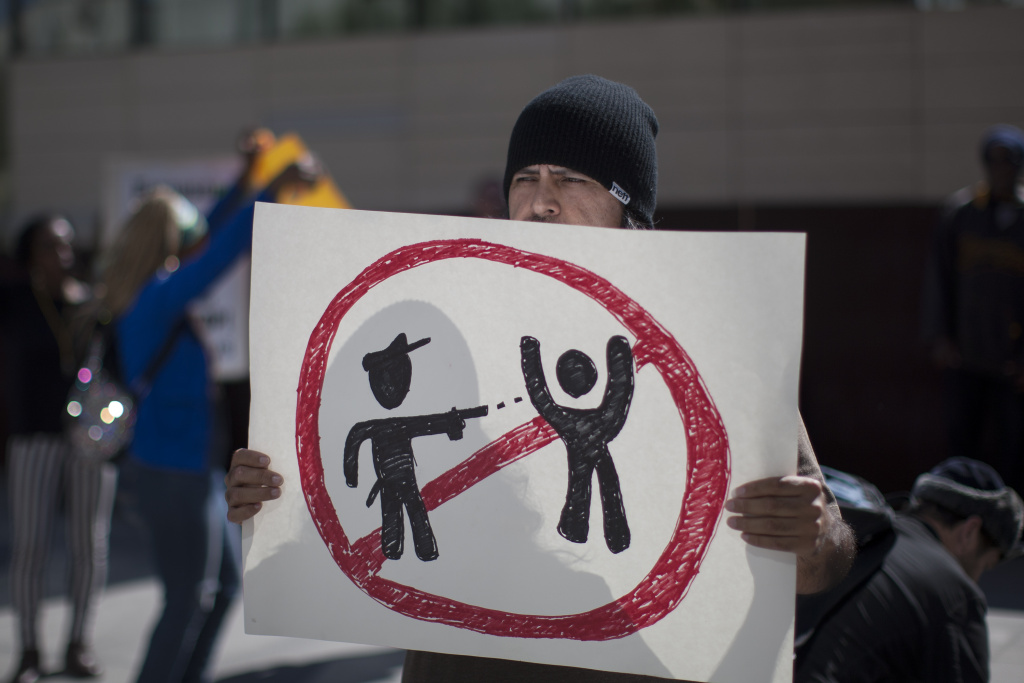 Protesters at Los Angeles Police Department Headquarters rally to express their anger over the fatal police shooting of an unarmed homeless man on March 3, 2015 in Los Angeles.