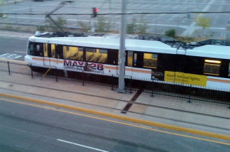 A Metro light rail train approaches the Little Tokyo stop of the Gold Line.