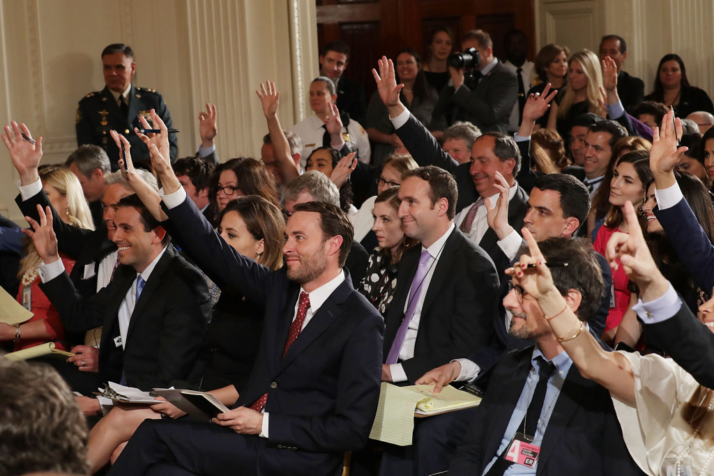 WASHINGTON, DC - MAY 18:  Reporters raise their hands to ask questions during a news conference with Colombian President Juan Manuel Santos and U.S. President Donald Trump in the East Room of the White House May 18, 2017 in Washington, DC. The Trump administration has said it wants to slash foreign aide and Santos will most likely  seek a renewal of $450 million dollars from the U.S. that supports the peace accord between the Columbian government at the Revolutionary Armed Forces (FARC).  (Photo by Chip Somodevilla/Getty Images)