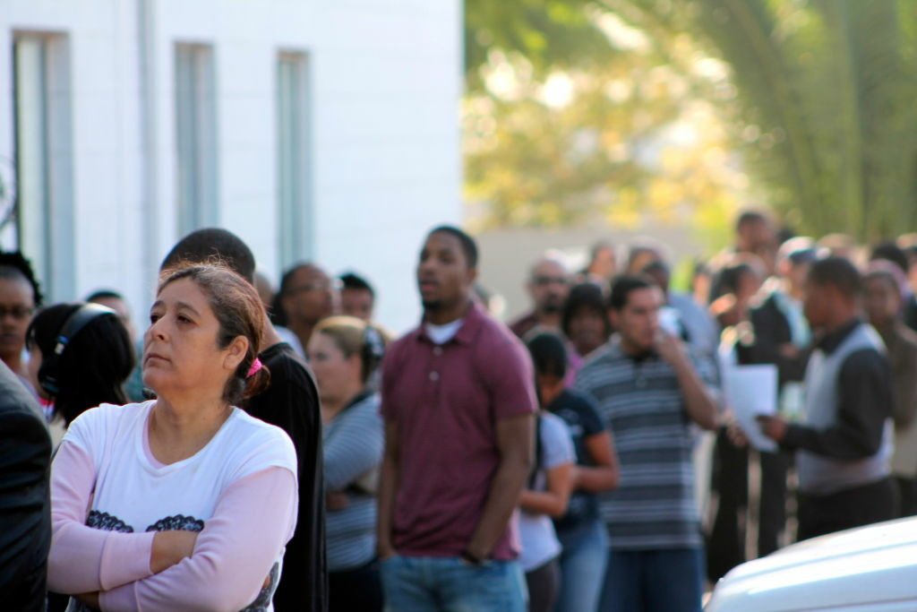 A line of job seekers wait to get into a Walmart hiring event at the Metropolitan Baptist Church in Altadena.