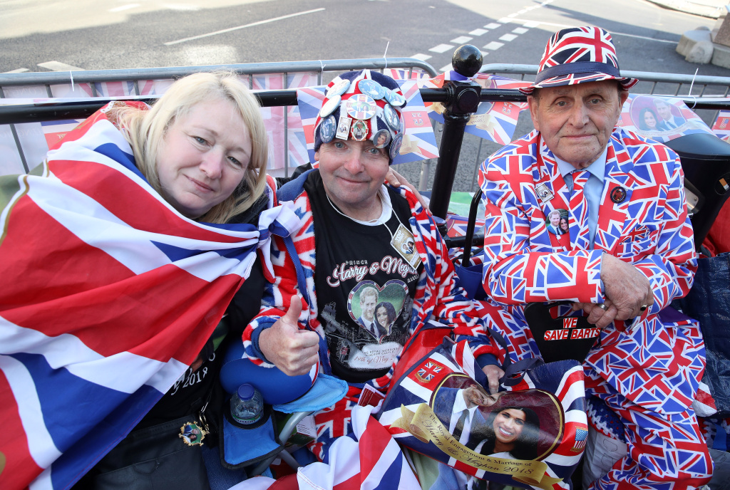 Royal fans John Loughrey (C) and Terry Hutt (R) pose for a photograph ahead of the dress rehearsal for the wedding of Prince Harry and Meghan Markle on May 17, 2018 in Windsor, England, but you don't have to travel across the pond to watch the wedding, there will be celebrations right here in SoCal.