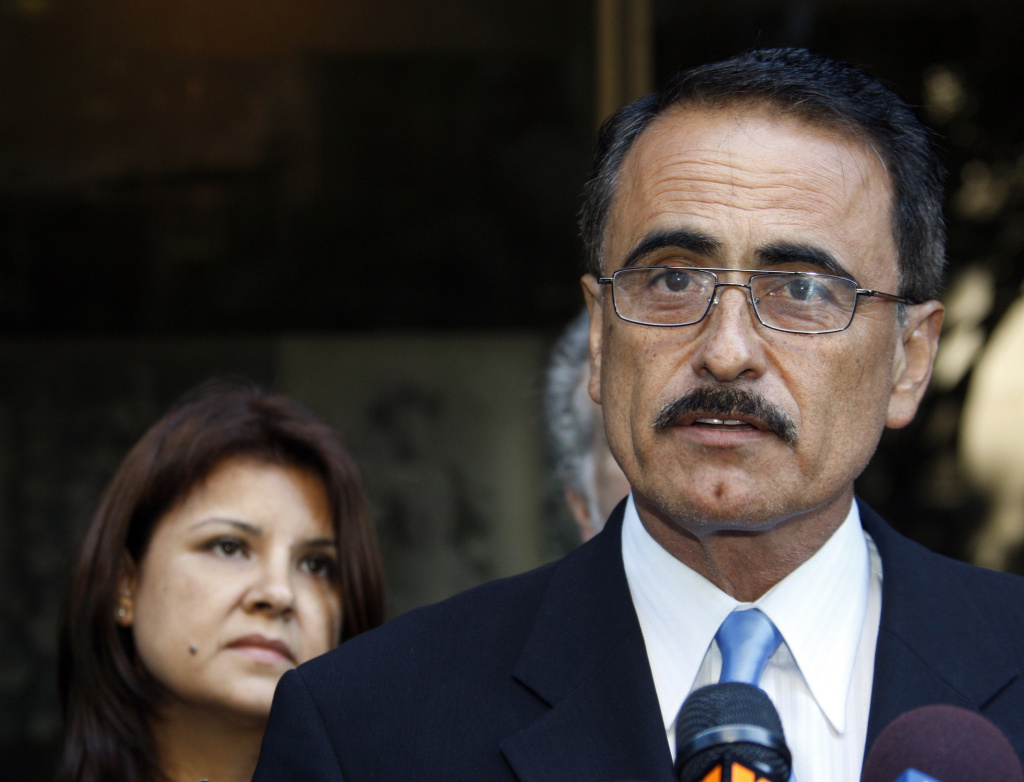 File photo: In 2010, then L.A. City Councilman Richard Alarcon, right, and his wife, Flora Montes De Oca Alarcon, speak to media outside court where they were indicted on a number of counts stemming from allegations he lived outside his district.