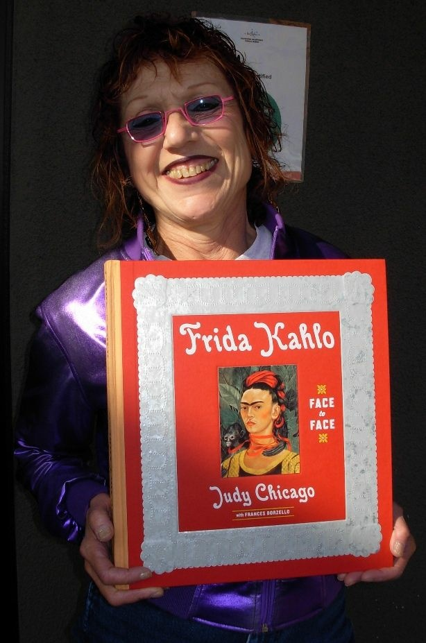 Artist Judy Chicago and her book.