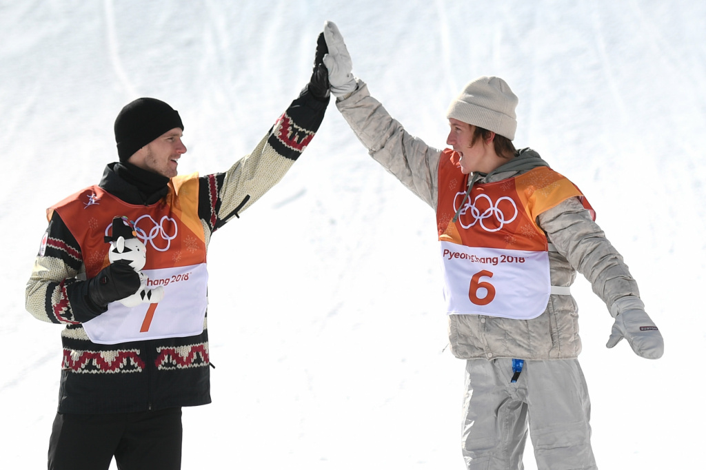 Seventeen-year-old Red Gerard (right), the first Team USA gold medalist of the Pyeongchang Games, gives Canadian silver medalist Max Parrot a high-five during the victory ceremony for men's snowboard slopestyle at the 2018 Pyeongchang Winter Olympics.