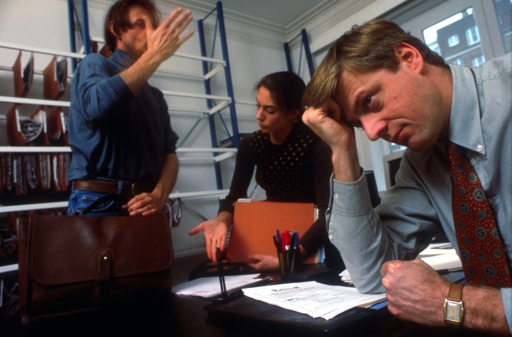 Stressed and agitated business people at work.