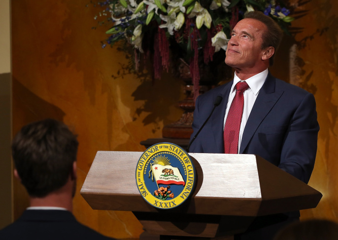 Former California Gov. Arnold Schwarzenegger (L) looks at his official gubernatorial portrait with his sons Patrick (C) and Christopher (R) during an unveiling ceremony in the Rotunda of the State Capitol on September 8, 2014 in Sacramento, California. Former California Gov. Arnold Schwarzenegger was joined by current Gov. Jerry Brown to unveil his official gubernatorial portrait at the State Capitol.