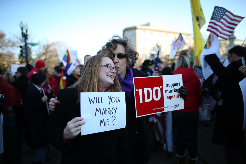 Andrea Grill (R) and Lee Ann Hopkins (L), from Alexandria VA. embrace after becoming engaged during a rally outside of the U.S Supreme Court, on March 26, 2013 in Washington, DC.