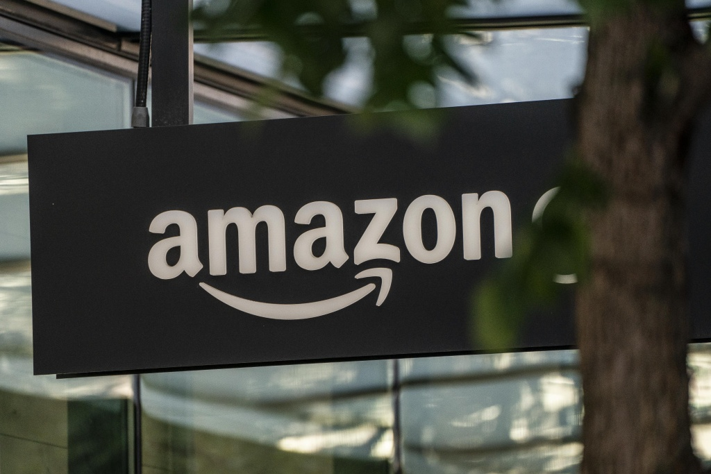 A sign is seen outside of an Amazon Go store at the Amazon.com Inc. headquarters on May 20, 2021 in Seattle, Washington.