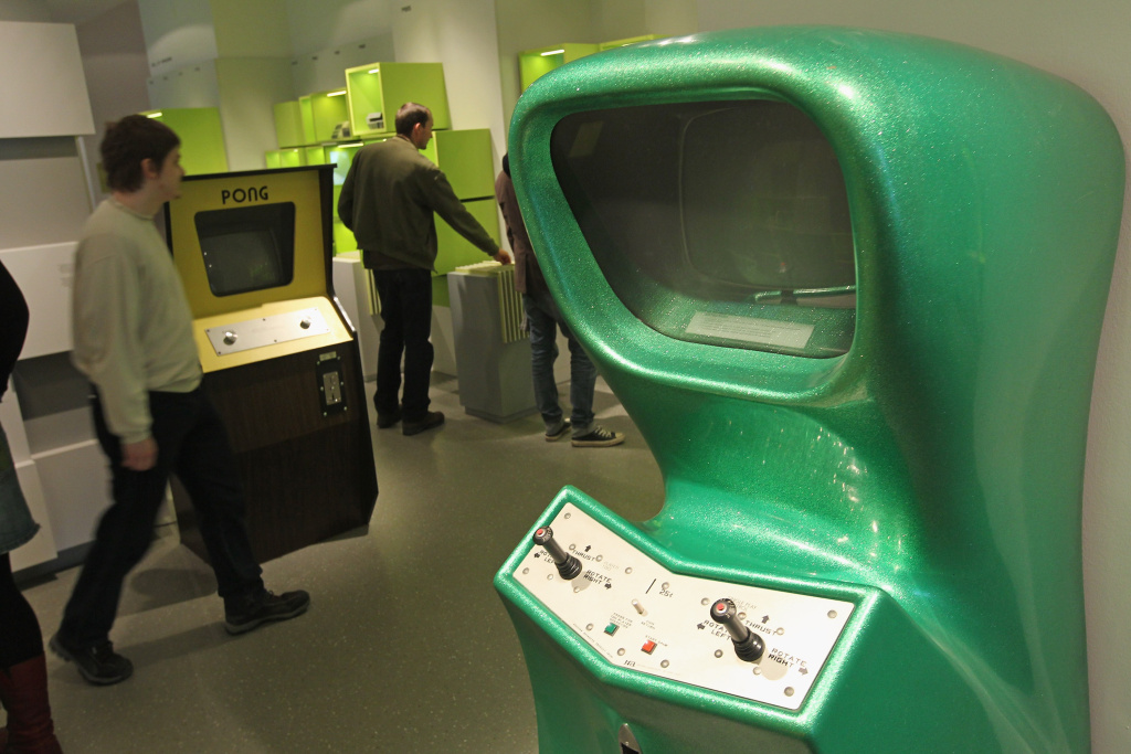 Visitors look at early computer video games, including Pong from 1971, at the Computer Game Museum (Computerspielemuseum) on January 26, 2011 in Berlin, Germany.