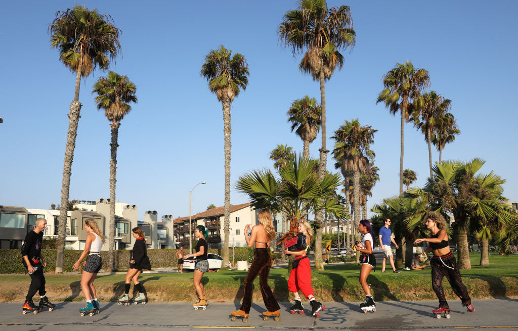 People roller skate along Venice Beach amid the COVID-19 pandemic on September 3, 2020 in Venice, California.