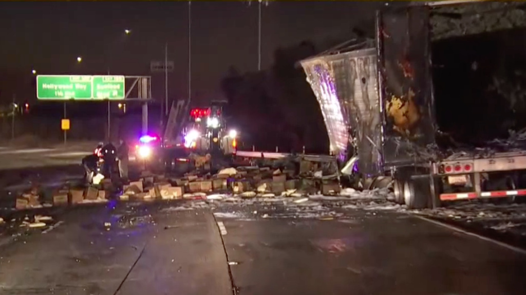 A big rig crash early Friday left the heavily traveled I-5 littered with the cargo of cheese and the burned wreckage of the tractor and trailer and forced a major diversion of traffic during the morning rush.