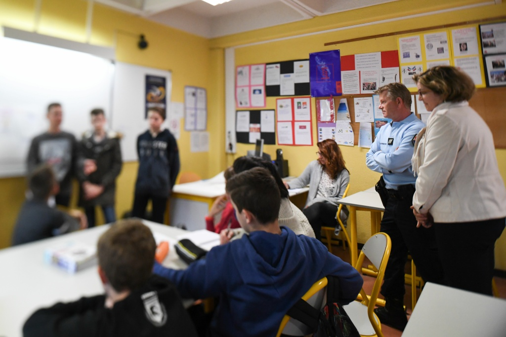 Students from the Yves Klein high school attend an anti-bullying meeting with headmaster Florence Gauthier and gendarmerie officer Christophe Olivier on March 6, 2017 in La Colle-sur-Loup, southern France.