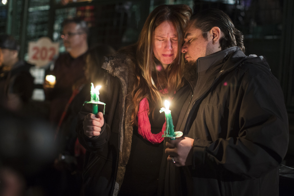 File: Jennifer and husband Roy Trules cry as the names of victims are read aloud during a moment of silence concluding a vigil at San Manuel Stadium in San Bernardino on Thursday night, Dec. 3, 2015. Both were friends with 26-year-old Aurora Godoy of San Jacinto.