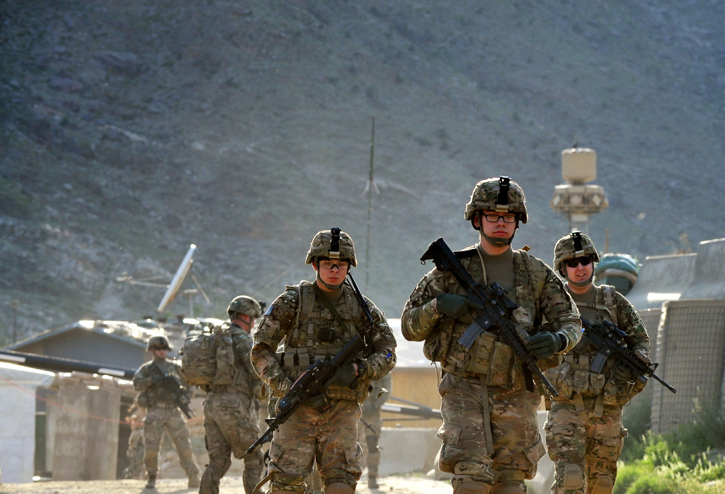 US army soldiers march from the Forward Base Honaker Miracle at Watahpur District in Kunar province during a joint patrol on April 18, 2013.