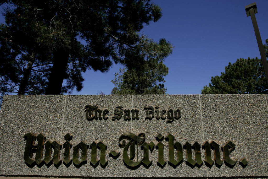 A sign sits on display at the front entrance to the offices of the San Diego Union-Tribune newspaper on March 18, 2009 in San Diego, California. Tribune Publishing Co. said Thursday that it completed its purchase of San Diego's dominant newspaper for $85 million. The paper immediately changed its name from U-T San Diego back to The San Diego Union Tribune.