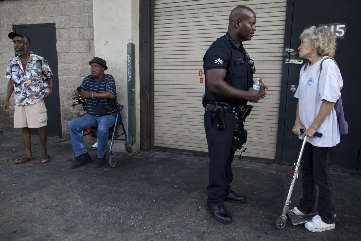 Physician Susan Partovi calls an ambulance for Louis Treaz after encountering him on 6th Street in Skid Row with a black eye and other visible heath concerns. Her triage work is part of a city and county program called Operation Healthy Streets to clean up Skid Row and encourage people living there to seek mental health and medical services.