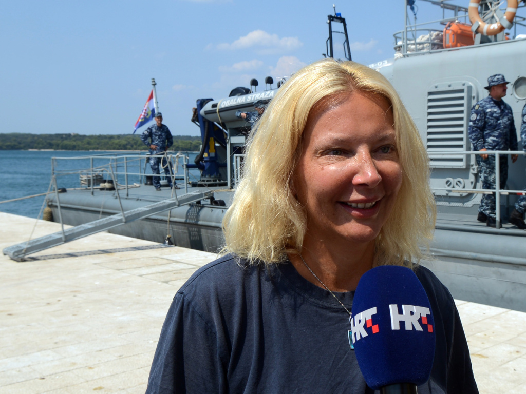 British tourist Kay Longstaff speaks to the media upon her arrival in Pula on a Croatian Coast Guard ship, on Sunday.