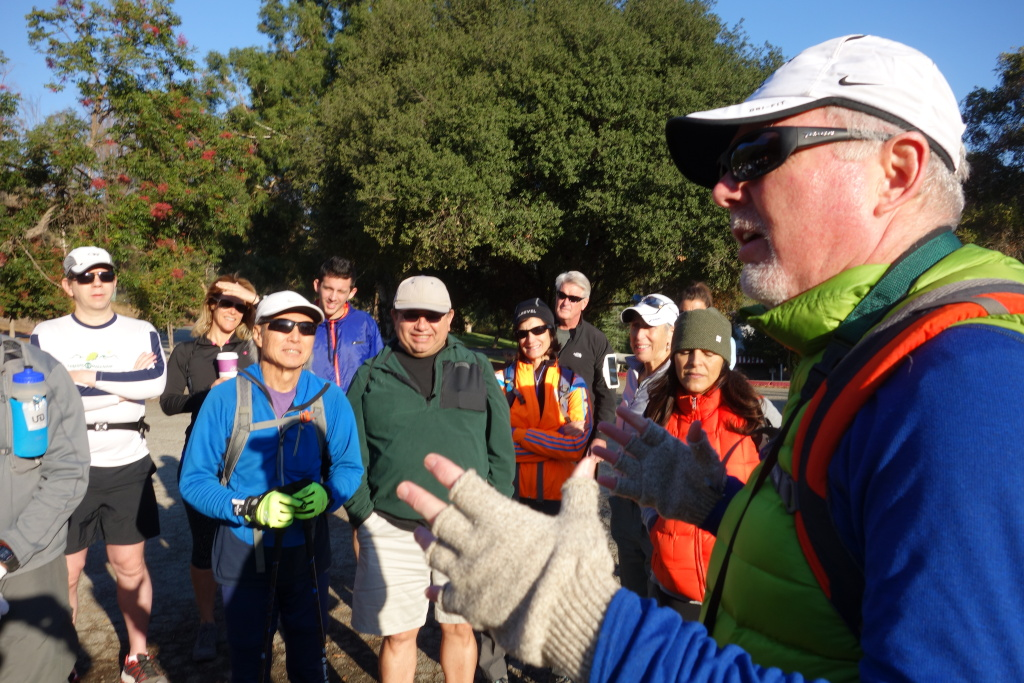 Hiker Mikey Lynch addresses friends in advance of a Black Friday hike in honor of the hike's originator, Phil Kent, who died two months before.