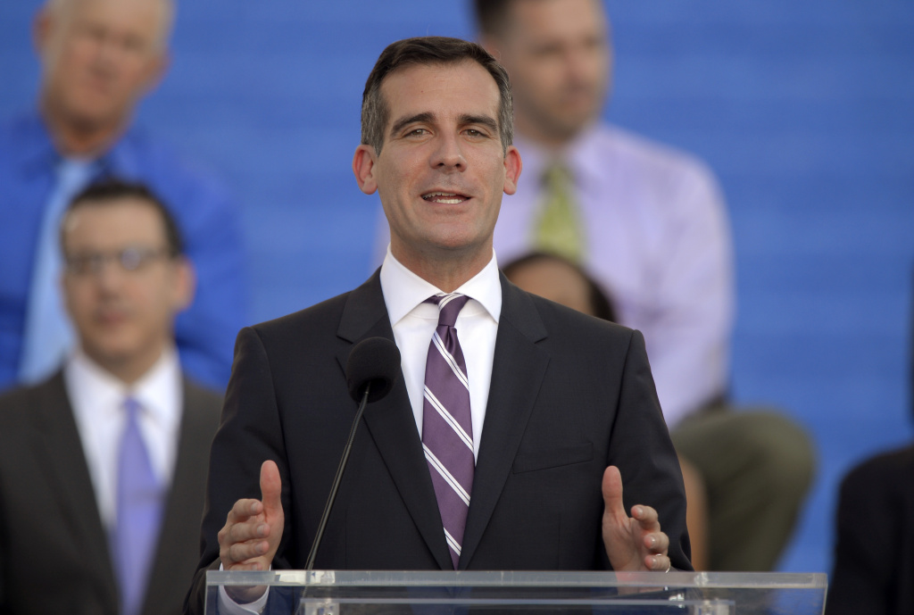 Los Angeles Mayor Eric Garcetti speaks in front of City Hall.