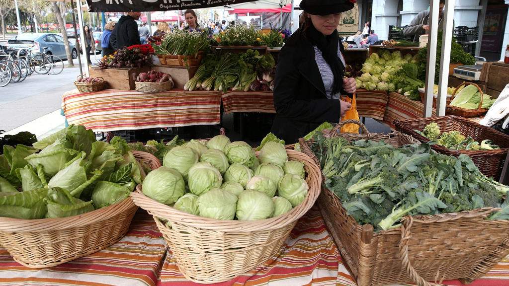 A customer shops for produce at the Ferry Plaza Farmers Market in San Francisco in March.