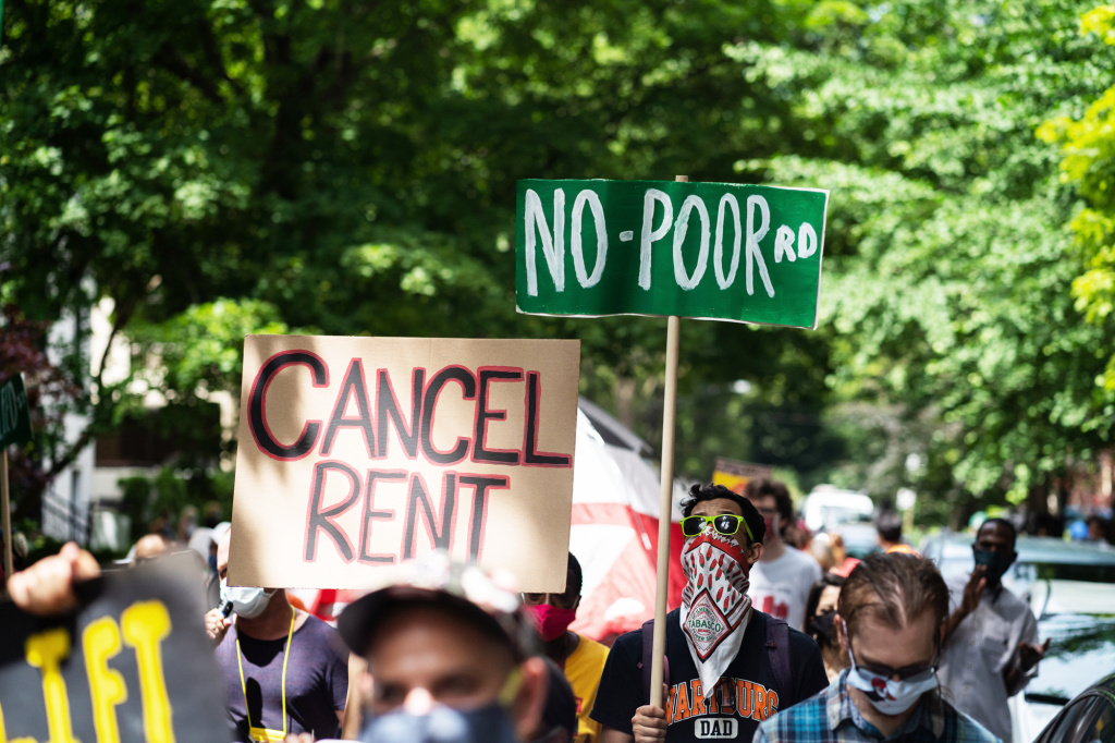 The pandemic's financial pressures cause many Americans to struggle with rent. Demonstrators march in the Old Town neighborhood of Chicago this June to demand a lift on the Illinois rent control ban and a cancellation of rent and mortgage payments.