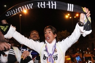 Real Madrid's defender Sergio Ramos celebrate in Madrid on April 20, 2011, after Real Madrid won the Spanish Cup final match against Barcelona. Real Madrid won 1-0.