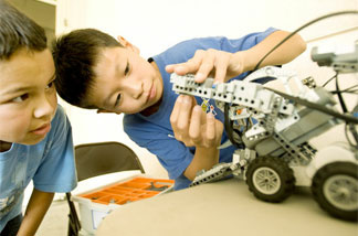 "Students work on their robot, ""Viper,"" at the 2008 Robot Rally."