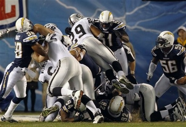 San Diego Chargers linebacker Takeo Spikes (51) can't stop a first-quarter touchdown plunge by Oakland Raiders running back Michael Bush (29) in an NFL football game Thursday, Nov. 10, 2011, in San Diego.