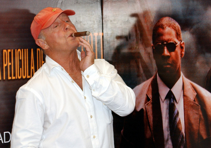 Film director Tony Scott smoks a cigar during a photo session during the press conference Monday Aug.t 9, 2004, in Mexico City, promoting the film 'Man on Fire', which was filmed in Mexico City, with Denzel Washington, Marc Anthony, Dakota Fenning and Christopher Waken.