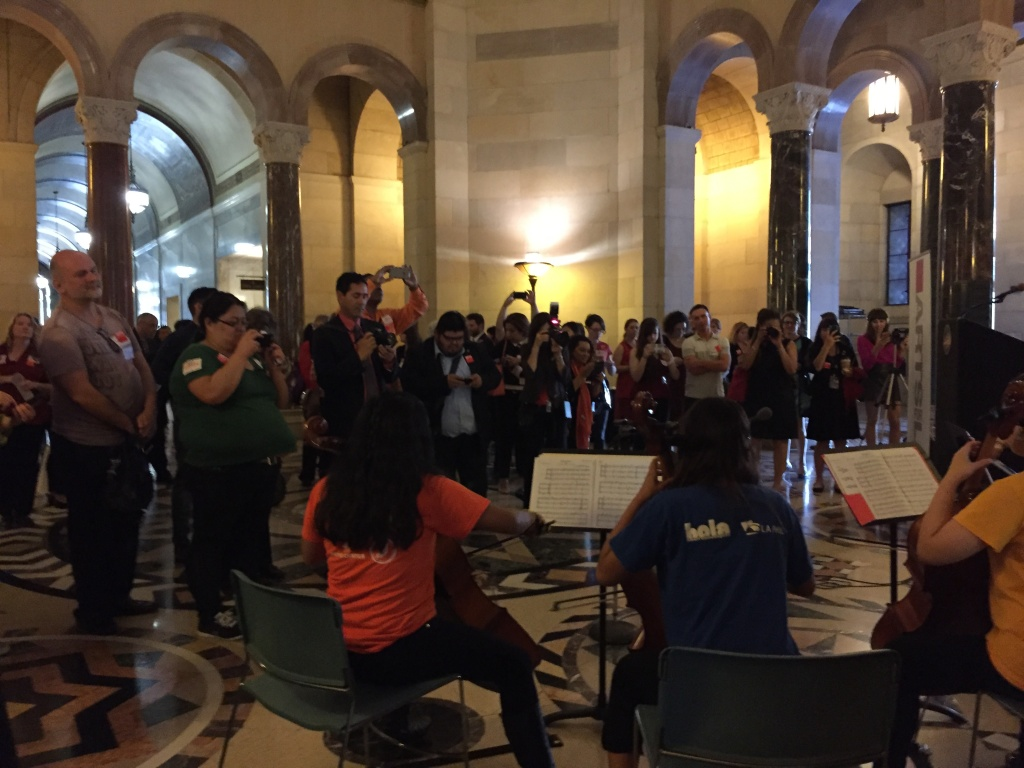 A group of young cellists from Youth Orchestra LA at the Heart of Los Angeles (YOLA at HOLA) played for advocates as they gathered in the rotunda ahead of the meeting.