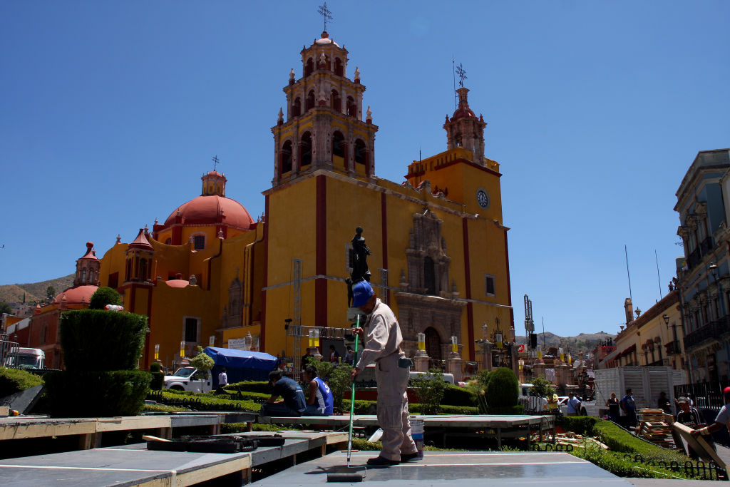 A  worker paints the stage in front of the Guanajuato basilica for Pope Benedict XVI to use during his visit to Guanajuato, Mexico on March 22, 2012. Pope Benedict XVI will visit Mexico between March 23 and 26 on his first visit to the country. AFP PHOTO/Hector Guerrero (Photo credit should read HECTOR GUERRERO/AFP/Getty Images)