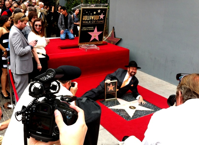The cripplingly shy Shotgun Tom Kelly poses with his star on the Hollywood Walk of Fame. That's Stevie Wonder in the upper left corner. 4/30/2013
