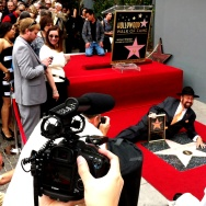 The cripplingly shy Shotgun Tom Kelly poses with his star on the Hollywood Walk of Fame. 4/30/2013