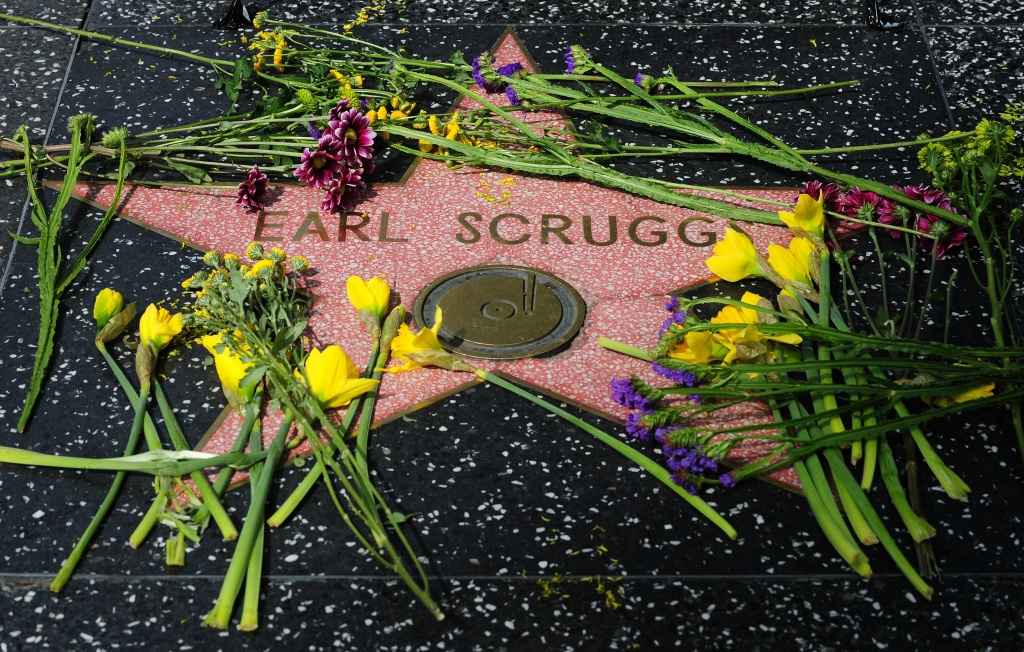 Flowers are placed on the Star along Hollywood's Walk of Fame for musician Earl Scruggs.