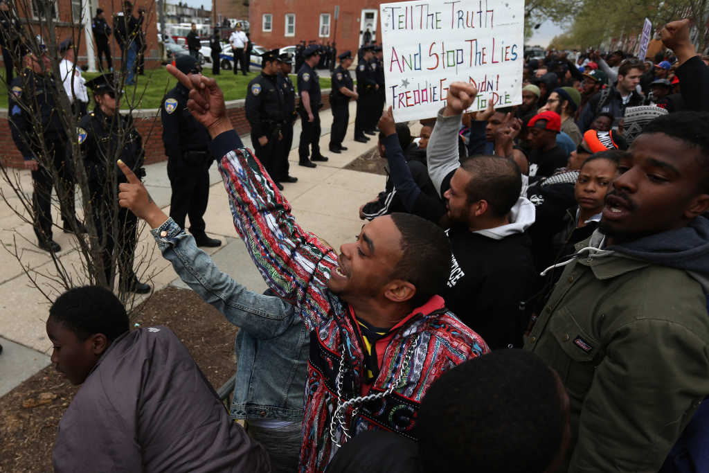 Hundreds of demonstrators rally in front of the Baltimore Police Western District station after marching from Baltimore City Hall to protest against police brutality and the death of Freddie Gray April 23, 2015 in Baltimore, Maryland. Protesters have promised to