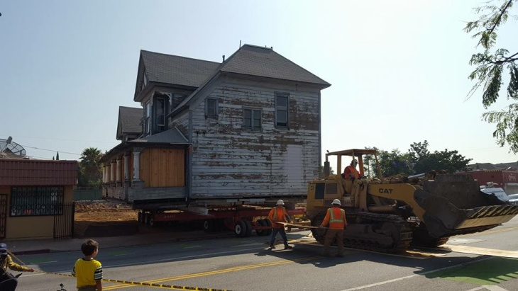 The 1895 Peabody Werden House being moved across the street on Thursday, June 30, 2016.