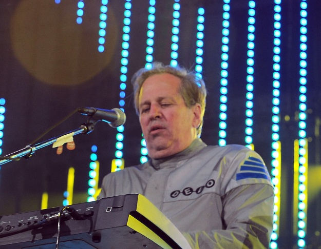 """This June 5, 2010 file photo shows Bob Casale performing live at The 2010 KROQ Weenie Roast in Irvine, Calif. Casale, of the band Devo best known for the 1980s hit """"Whip It,"""" died Monday, Feb. 17, 2014, from conditions that led to heart failure, his brother and band member Gerald Casale said Tuesday. He was 61. Devo founder Gerald says in a statement his younger brother's death was """"sudden"""" and """"a total shock."""""""