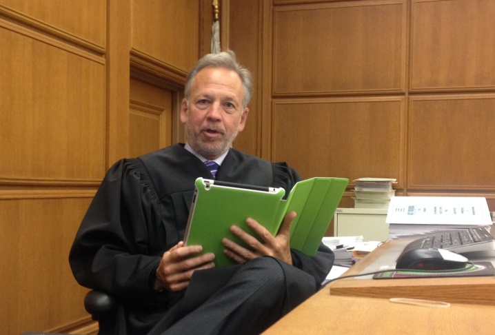 L.A. Superior Court judge Michael Linfield holds up an iPad that is identical to the ones jurors are using in a case in his courtroom. It's the first time at L.A. Superior Court that jurors have been provided iPads to review evidence in a case.