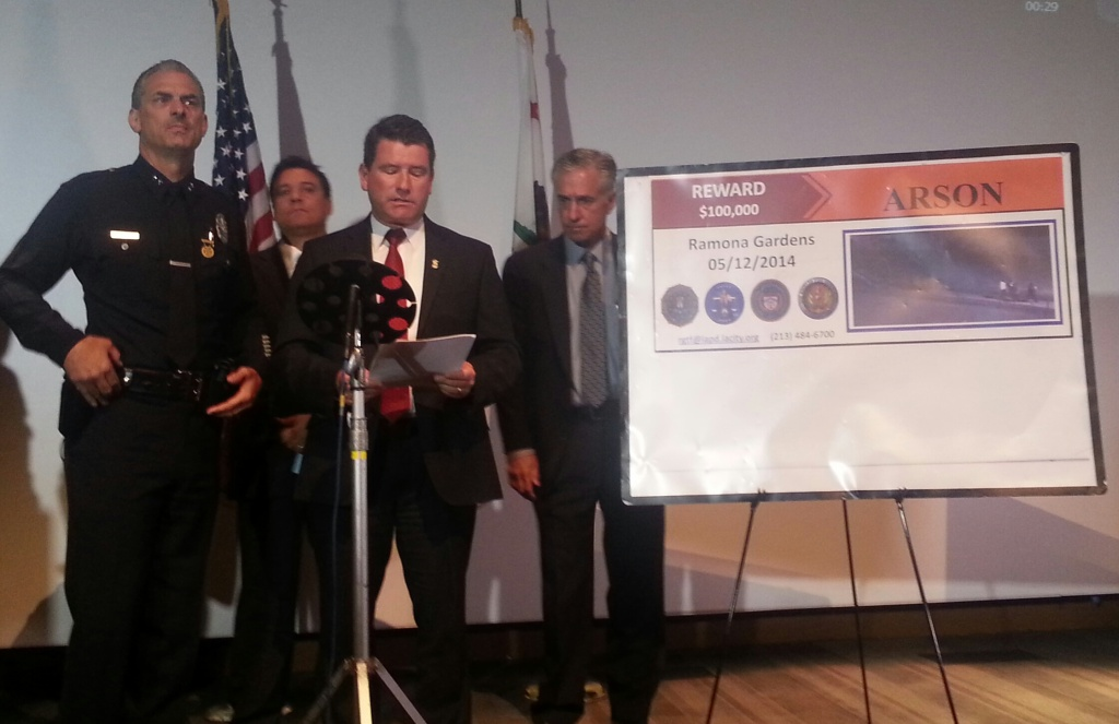 FBI agent Tim Delaney announces a $100,000 reward in the Ramona Gardens firebombing on May 12, 2014. Officials believe the firebombing may have been racially motivated.