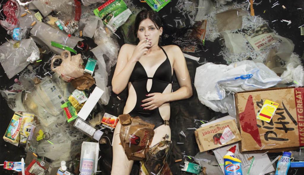7 Days of Garbage is an art exhibit that shows what seven days of trash looks like for different people.