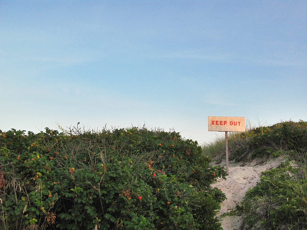 beach keep out sign